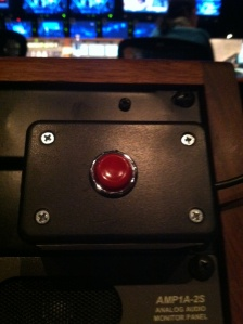 The applause button for a live television taping. An indicator of the immediacy of television producing