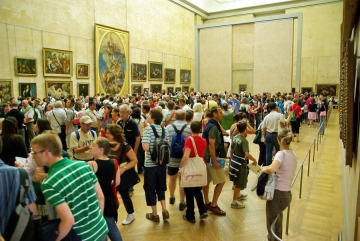 Tourists In Louvre Museum