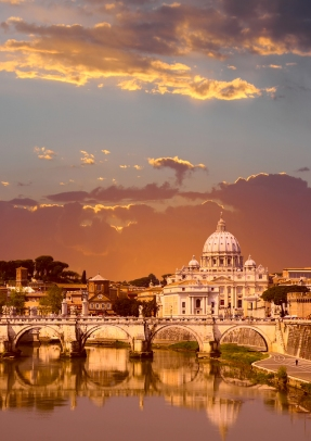 Sunset view of the Vatican with Saint Peter's Basilica and Sant'Angelo's Bridge (Rome Italy)